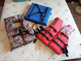 2 life Vests and Boat Cushion