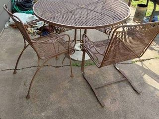 Patio Table  1 Foot is Broke  with 4 Chairs  1 Chair Rocks