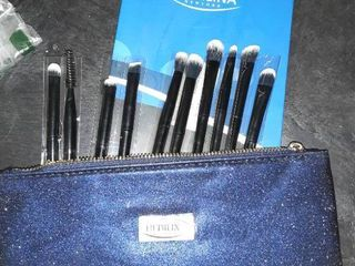 Miscellaneous bag of goodies  Makeup eye brush kit  ceramic knife and more