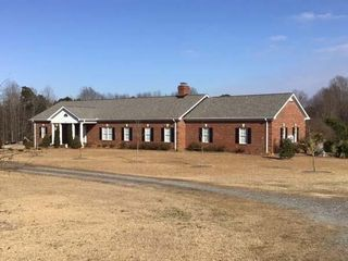 Brick Executive Home + 25 acres