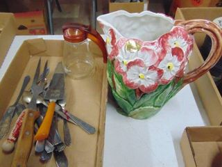 A Flower Pitcher and Serving Utensils