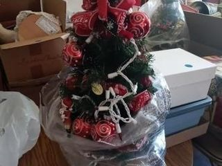 MINIATURE CHRISTMAS TREE THAT IS lIGHTED AND