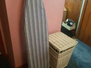 23  WICKER ClOTHES BASKET AND A IRONING BOARD