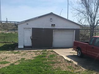 Lot with Garage Selling to the Highest Bidder