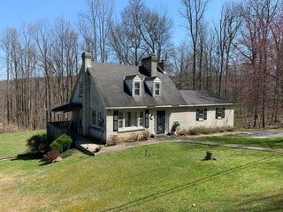 4 BR CAPE COD HOME ON .66 ACRES