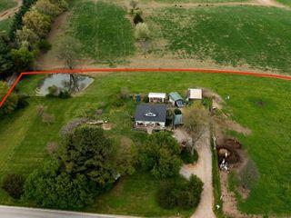 4 BR/1 BA FARM HOUSE ON 4.29 +/- ACRES