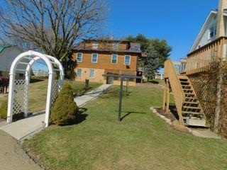 AUCTION POSTPONED 2-Homes, 2-Barns, 2-Shops on