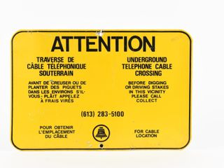 ATTENTION UNDERGROUND TElEPHONE CABlE S S SIGN
