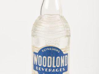 WOODlOND BEVERAGES 10 OZS  EMBOSSED BOTTlE