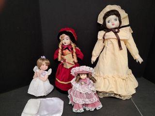 4 Assorted Porcelain Dolls