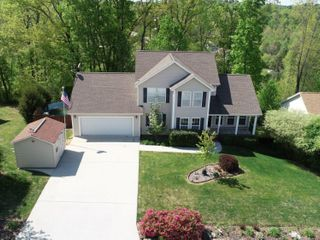 AUCTION featuring 3 BR, 2.5 BA Home with Bonus Room, Office, Basement and Additional Unimproved Lot Selling As a Whole
