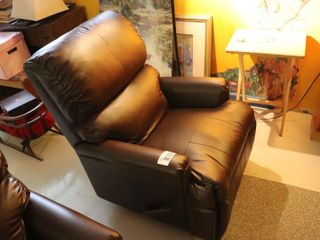 lEATHER REClINING CHAIR   RIP IN HEADREST